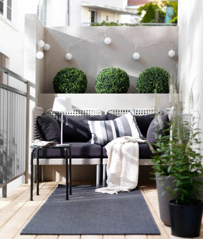 ideas-para-decorar-la-terraza-muebles-de-ratan-sofa-lamparas-decoracion