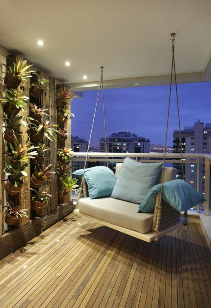 ideas-para-decorar-la-terraza-oscilación-cojines-plantas-de-pared