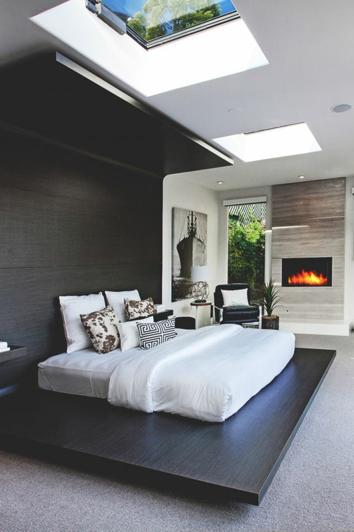 casa-minimalista-dormitorio-pared-de-madera-techo-con-ventanas-diseño-moderno