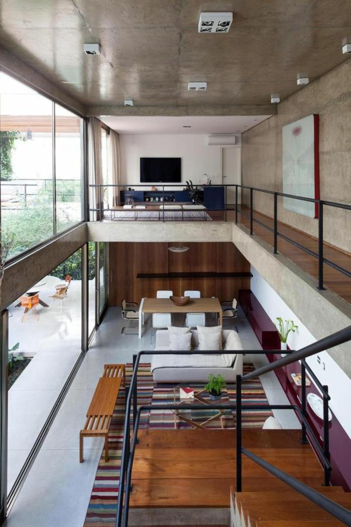casas-minimalistas-dos-pisos-abiertas-muebles-en-tonos-naturales-ventanas-francesas