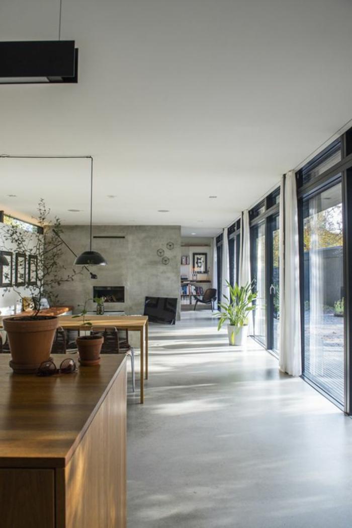 casas-minimalistas-espacio-grande-cocina-de-madera-ventanas-francesas-tonos-grises