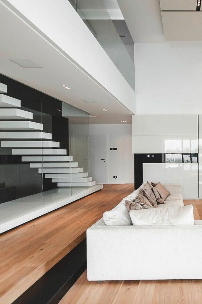 casas-minimalistas-grande-pared-de-vidrio-sofá-blanco-cocina-en-blanco