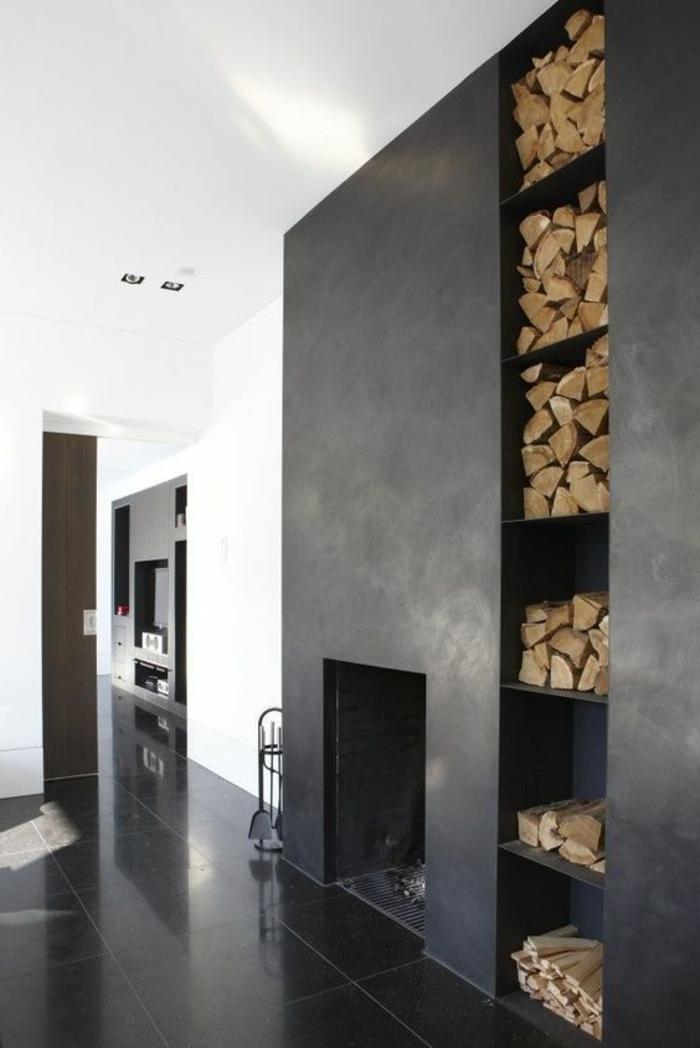 casas-minimalistas-sala-de-estar-en-negro-y-blaco-chimenea-leñas-en-la-casa