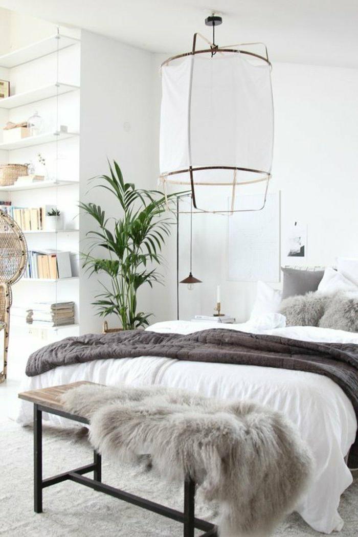 decoracion-de-dormitorios-doble-cama-manta-gris-lámpara-grande-paredes-blancos