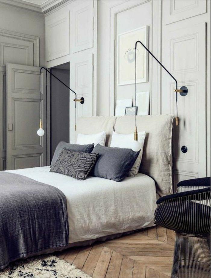 decoracion-de-dormitorios-tonos-grises-cojines-decorativos-lamparas-interesantes-sillón