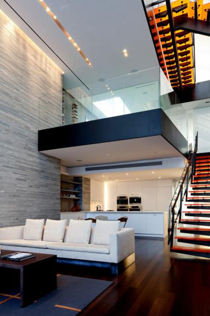 decoración-minimalista-suelo-de-madera-dos-pisos-escalera-sofa-blanca