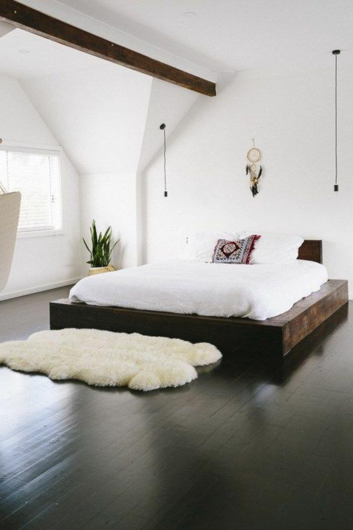 decoracion-minimalista-dormitorio-cama-de-madera-paredes-blancas-suelo-de-madera
