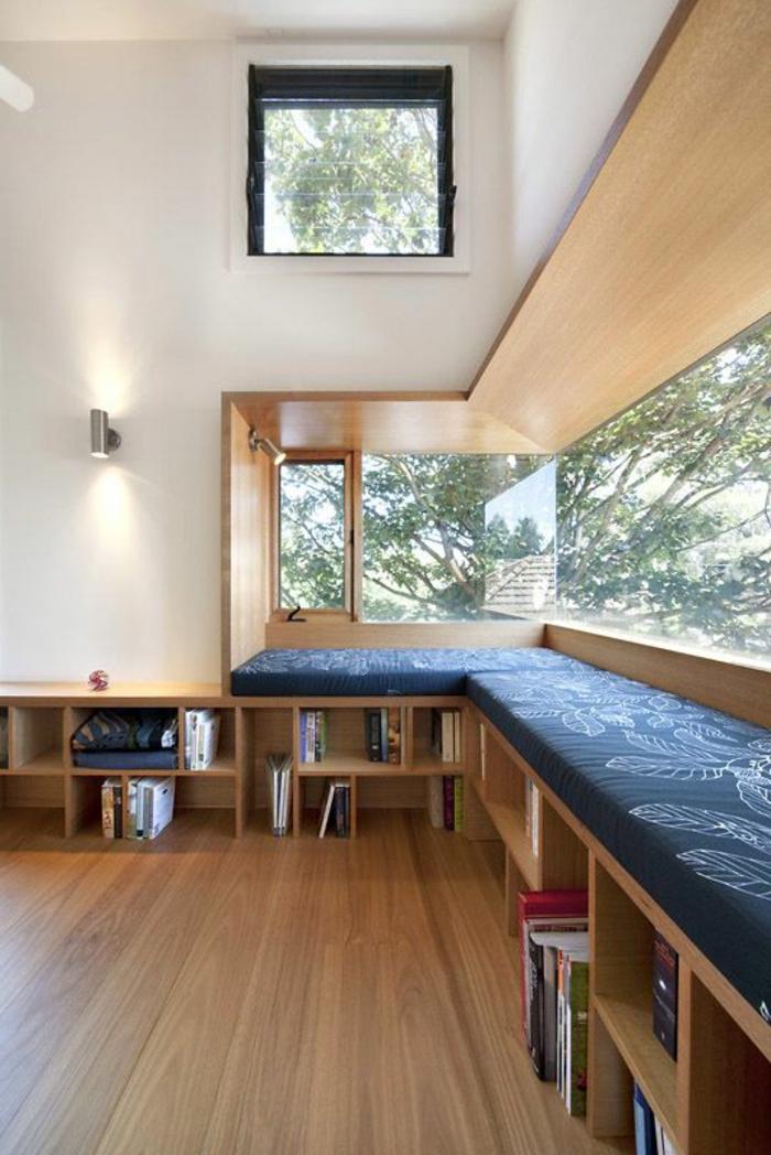 decoracion-minimalista-ventana-grande-elementos-de-madera-libreria-tonos-naturales