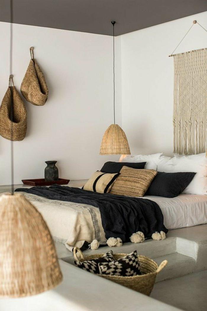 dormitorios-de-matrimonio-colores-naturales-manta-en-negro-cojines-estilo-rústico