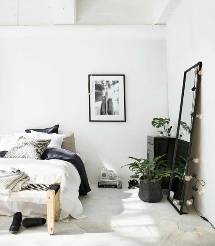 dormitorios-de-matrimonio-espejo-grande-lamparas-de-decoración-cuadro-en-la-pared