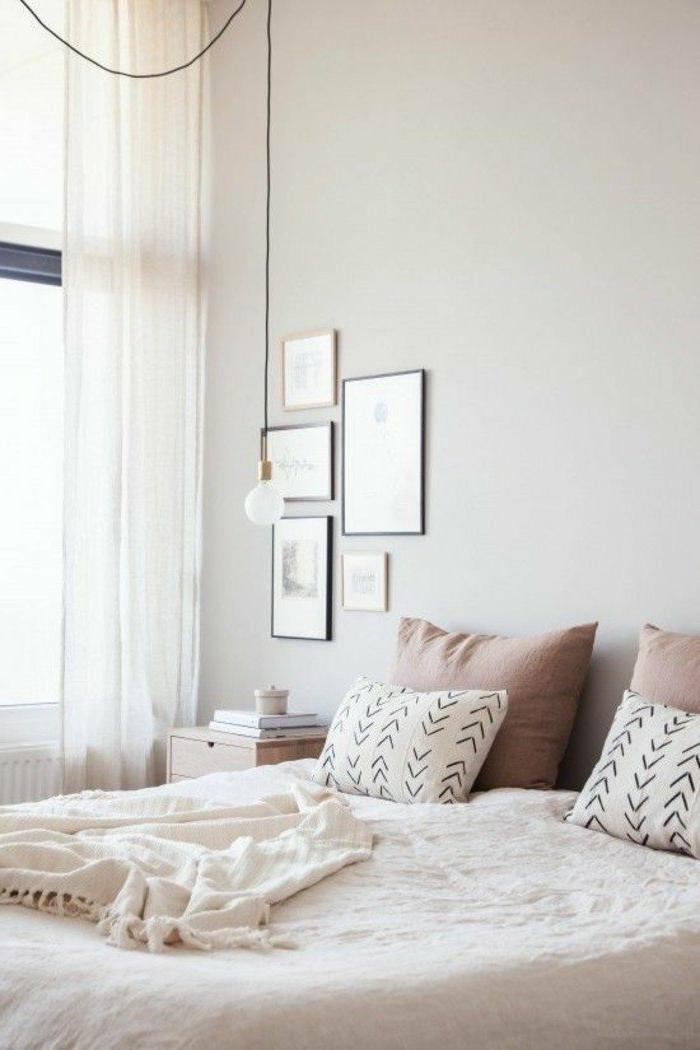 dormitorios-matrimonios-acogedor-en-colores-naturales-cojines-pequeños