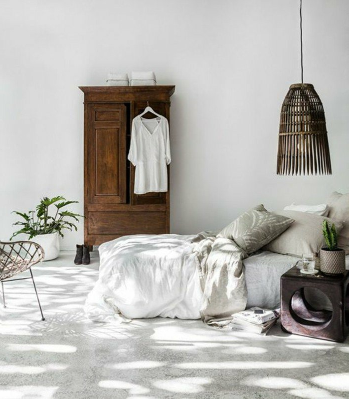 dormitorios-modernos-armario-de-madera-lámpara-de-madera-cama-en-blanco