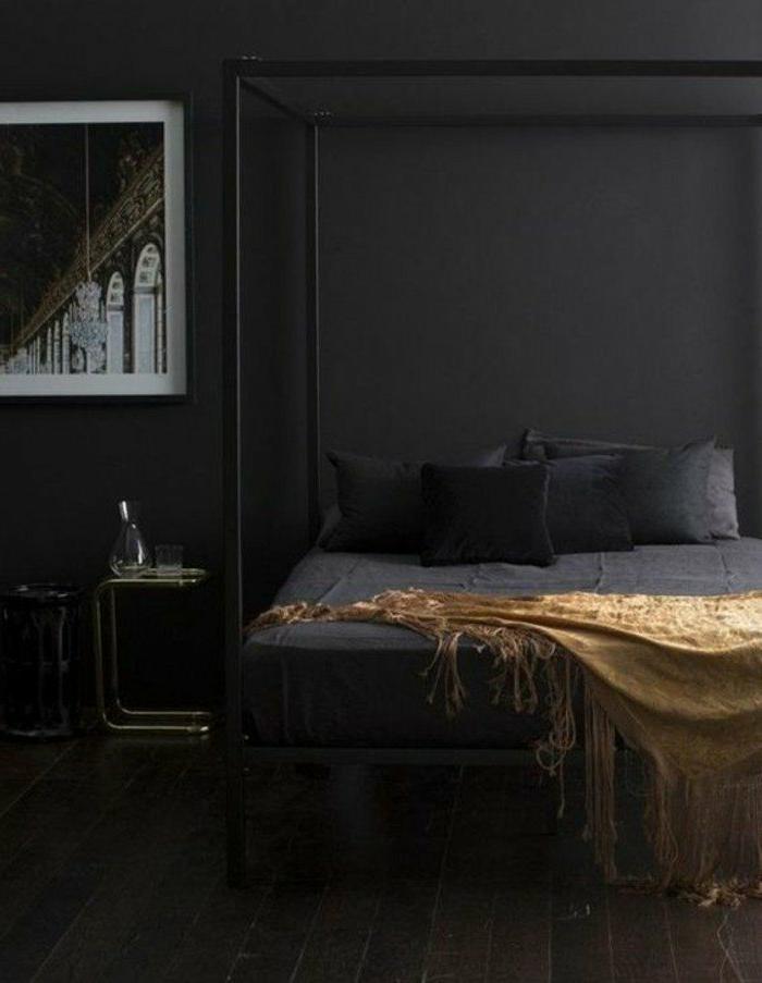 dormitorios-modernos-cama-de-metal-paredes-gris-oscuro-manta-color-oro