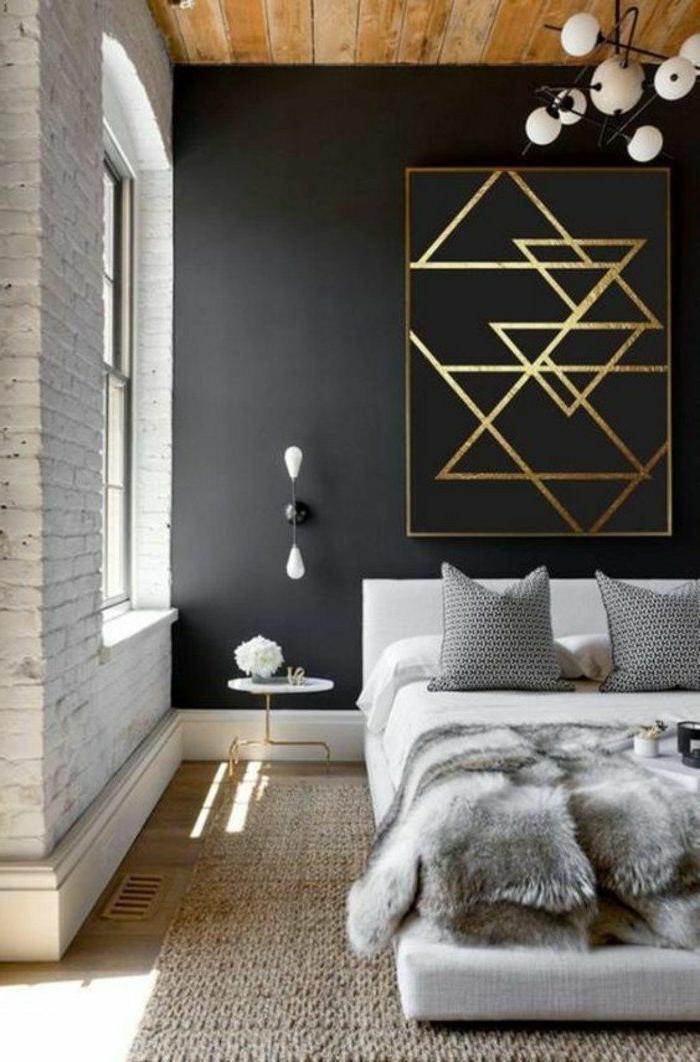 dormitorios-modernos-pared-de-ladrillos-cuadro-modernista-grande-cojines-gris
