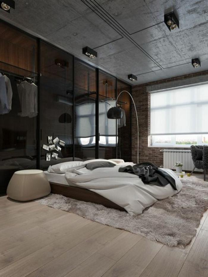 fachadas-modernas-dormitorio-tonos-oscuros-lámpara-de-diseño-alfombra-grande-suelo-de-madera