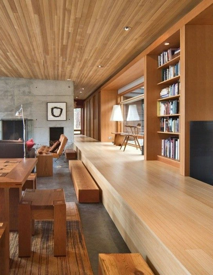 fachadas-modernas-muebles-de-madera-librería-ventanas-grandes-tonos-naturales
