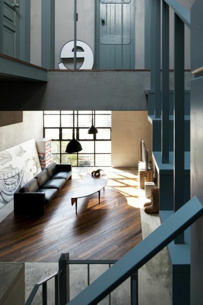 fachadas-modernas-sofa-negro-suelo-de-madera-dos-pisos-tonos-azules-mesa-de-madera