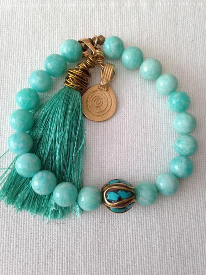 pulseras-de-plata-piedras-preciosas-borla-azul-elementos-de-oro