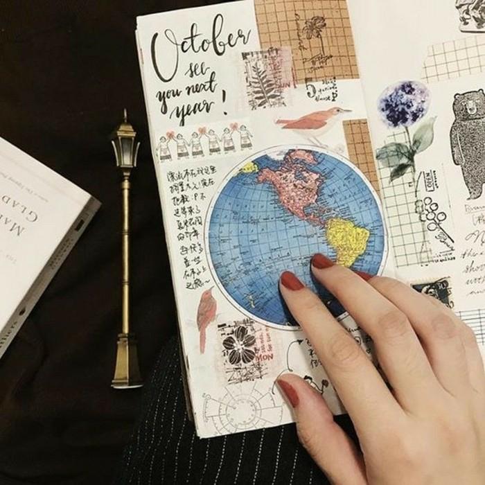 cuaderno-de-viaje-con-muchos-pegatines-dibujos-memorias-diario-mapa-del-mundo