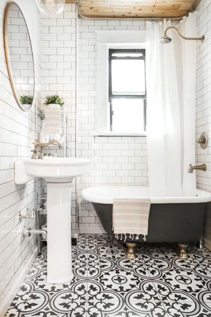 baños modernos, decoración simple, tonos claros, espejo redondo, bañera negra