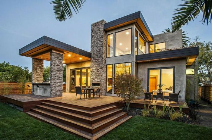 casas modernas, villa de diseño irregular con columnas de piedra, ventanales y patio
