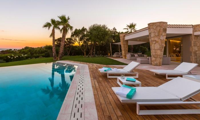 casa y campo, villa de piedra y hormigon con patio de madera, piscina y palmeras