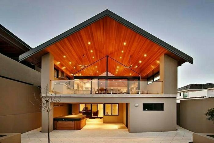casas modernas, villa de dos pisos con techo triangular y patio abierto