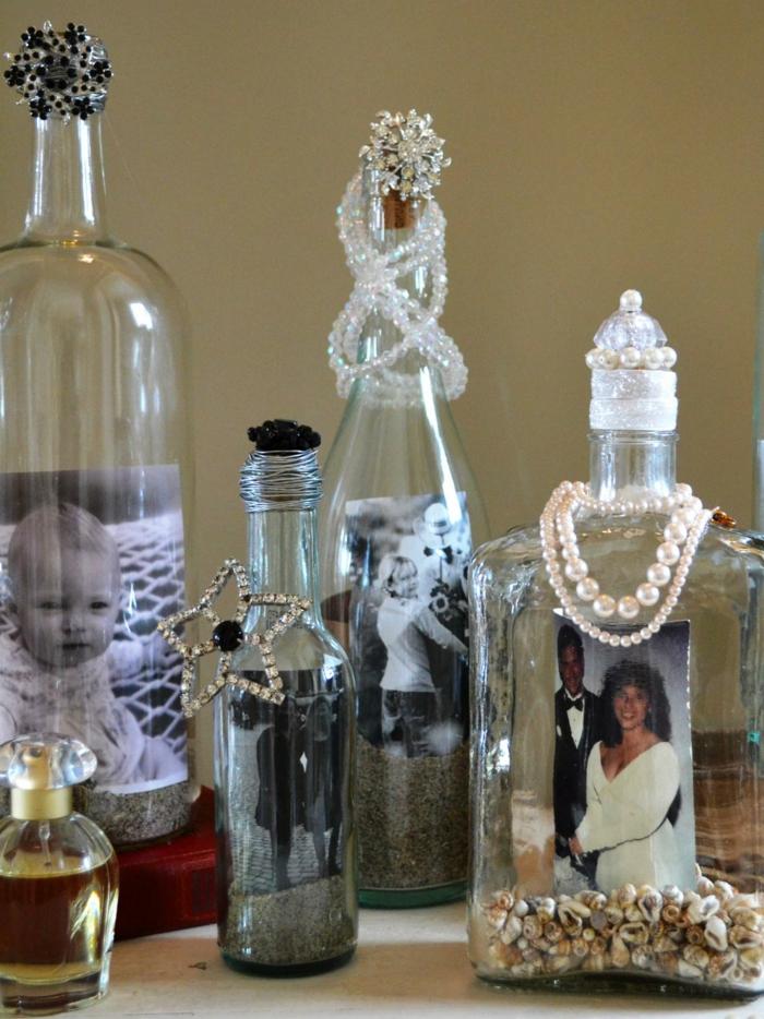 decoracion, fotos en botellas de vidrio, adorno con conchas y joyas