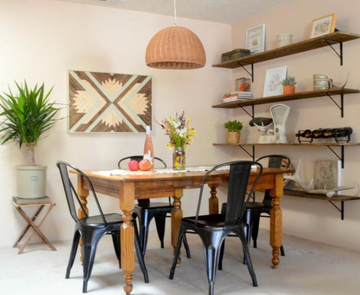 decoracion de comedores, mesa de madera, sillas de metal negro, estanterías, cuadro, planta, baldosas