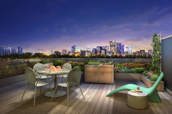 decoracion de terrazas, terraza con vista a la ciudad, silla cama verde, mesa redonda con sillas, armario, suelo de madera