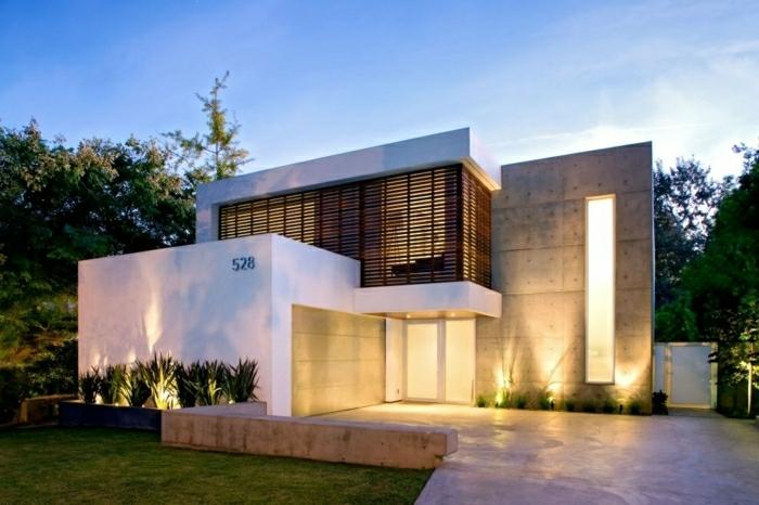 diseñar casas, villa con techo plano de madera y concreto con garaje