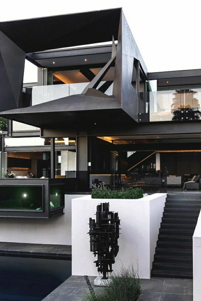 fachadas de casas, villa de diseno irregular en blanco y negro