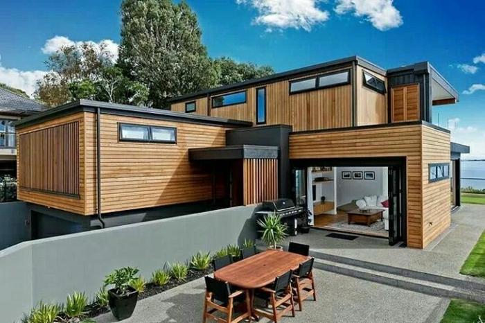 fachadas modernas, casa de contenedores cubiertos de madera clara con patio