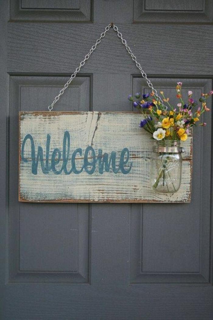 cartel de bienvenida, madera, frasco de cristal, flores
