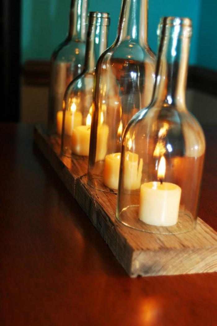 porta velas con botellas de vidrio y madera