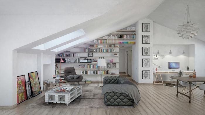 como hacer una mesa con palets, salón con estanterías de libros, mesa blanca de palets, sofá y lámpara