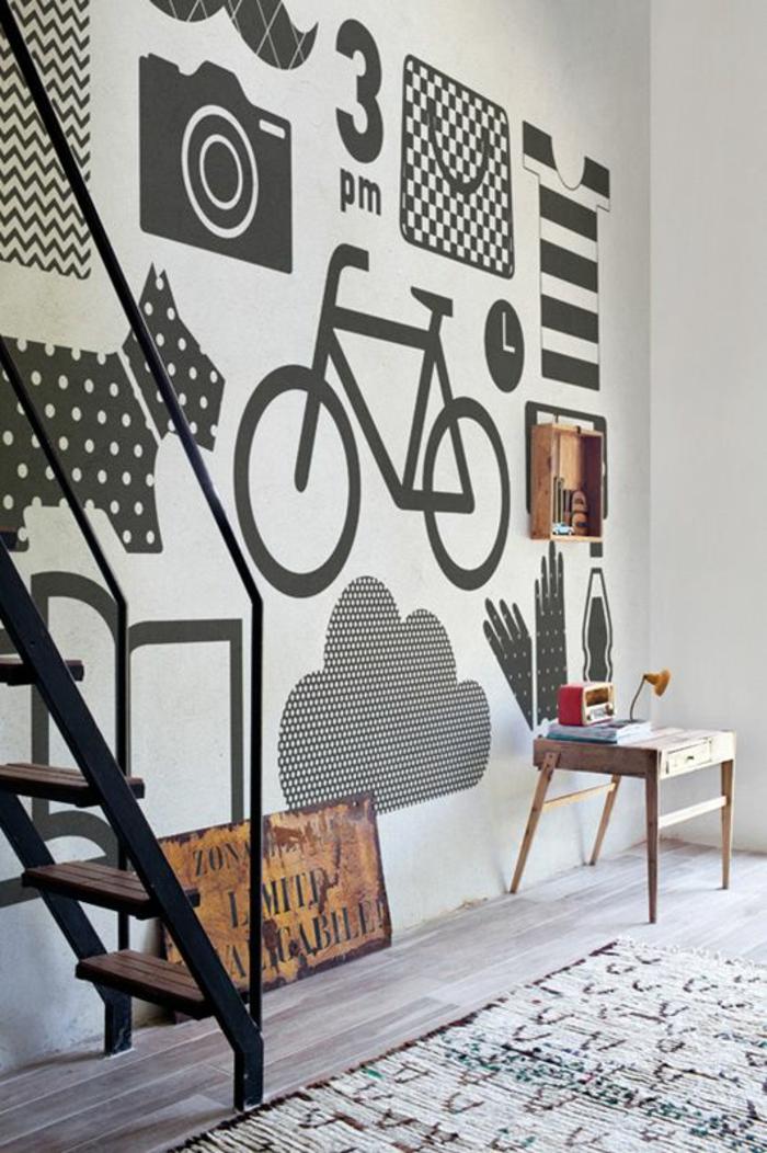 paredes decoradas, decoracion de pared con collage de imagenes en blanco y negro, bicicleta, perro, cámara
