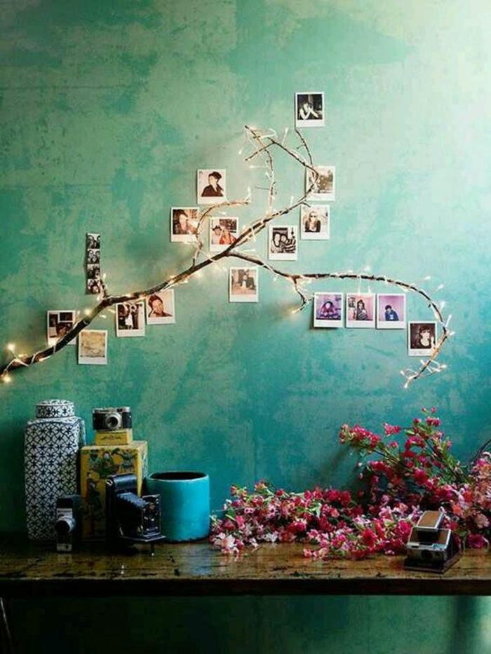paredes decoradas, decoración con iluminada rama de árbol y fotos