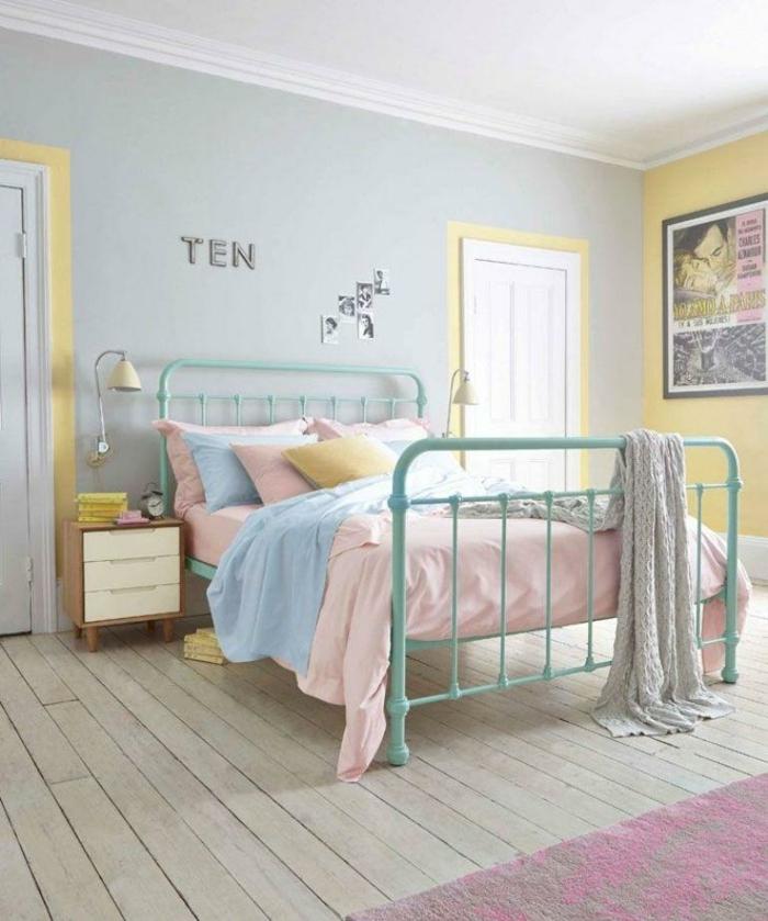 decoracion nordica, dormitorio con cama y mesa de noche, paredes en amarillo y azul pastel