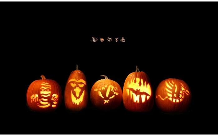 calabazas de Halloween, cinco calabazas talladas con dragón, murciélago, momia
