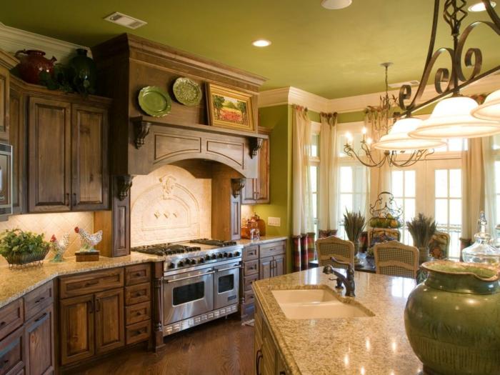 cocinas de obra, cocina rústica de madera con isla con fregadero, ventanales y decoracion con platos verdes