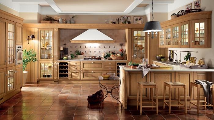 cocinas de obra, cocina rústica de madera clara con barra, suelo de baldosas y campana extractora blanca
