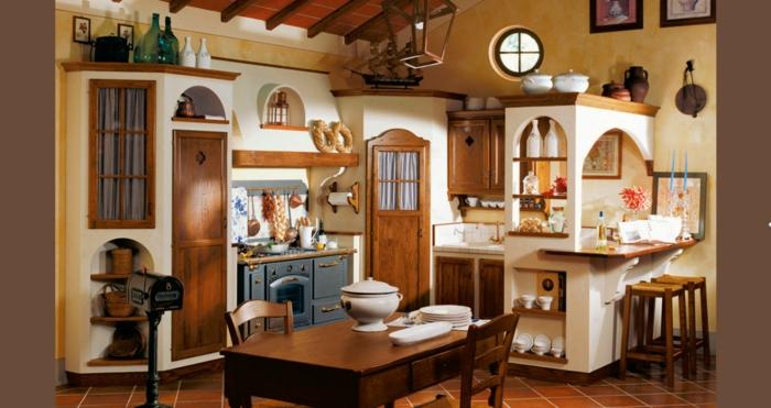 cocinas modernas pequeñas, cocina en madera y beige, horno azul, mesa y barra con sillas altas
