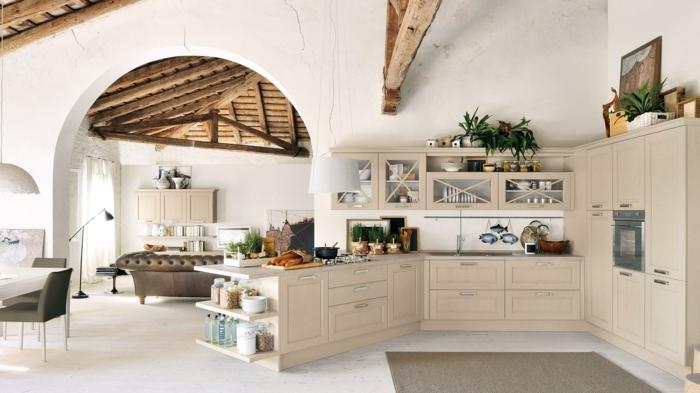 cocinas modernas pequeñas, cocina abierta hacia el salón, madera clara, suelo azulejos y tapete. vigas en el techo