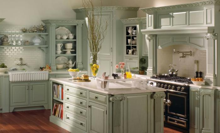 cocinas vintage, cocina en verde pastel con isla , fregadero y alacenas retro
