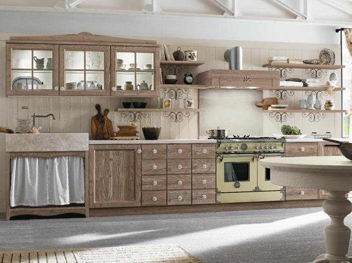 cocina rustica, cocina de madera clara con mesa redonda, horno en amarillo pastel