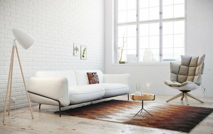 salones con encanto, salón moderno pequeño con sofá blanca, tapete y mesa muy pequeña redonda, pared de ladrillo blanco, ventanal
