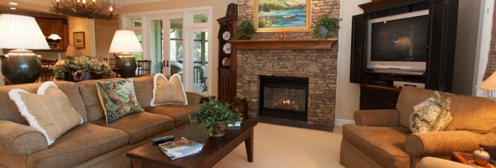 mueble salon, salon rustico con chimenea de piedra, sofa con cojines y mesa