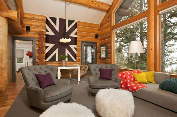 mueble salon, salon rustico con sillones grises, pared de madera y bandera