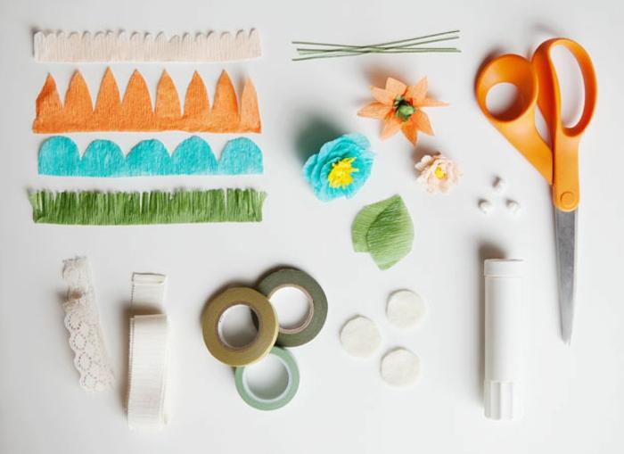 como hacer flores de papel, materiales necesarios para hacer flor de papel crêpe, cinta, tijeras y bolas de algodon
